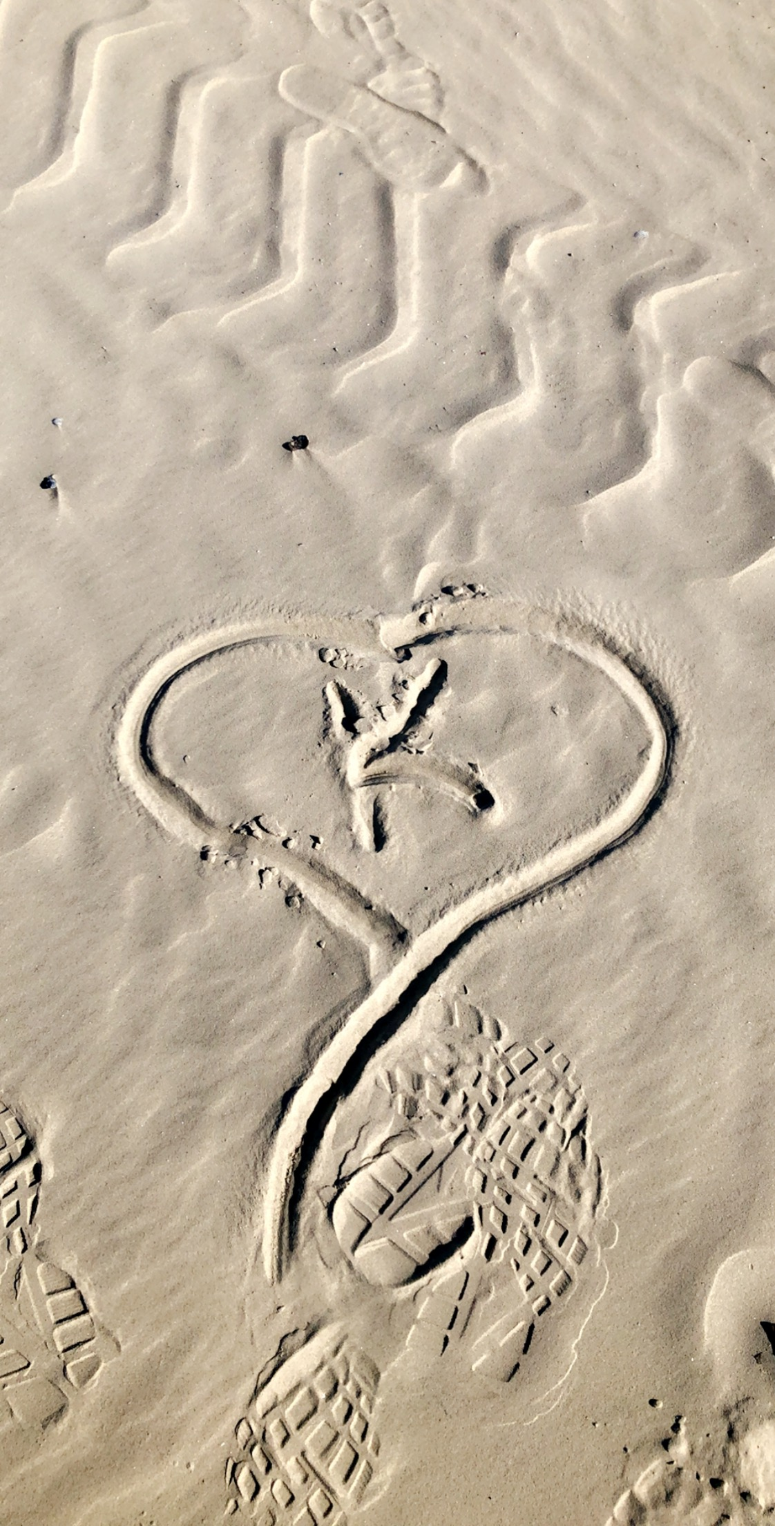 This picture is one that I took at the beach of the sand, while on lunch break. If you look closely you can see my sneakers foot print. The K that I traced in the sand with a stick stands for Krystal-my name.